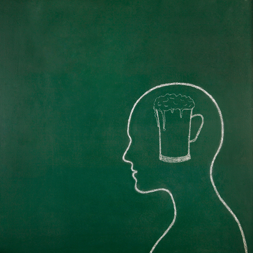 Mug with beer inside of human head draw on blackboard